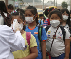 Elementary school students wait in a line to receive a temperature check at a school in Pyeongtaek, South Korea, June 15, 2015. Thousands of South Korean schools that were shut to stop the spread of Middle East Respiratory Syndrome (MERS) reopened on Monday as the country sought to return to normal, nearly four weeks into an outbreak that shows signs of slowing.   REUTERS/Han Sang-kyun/Yonhap   ATTENTION EDITORS - THIS IMAGE HAS BEEN SUPPLIED BY A THIRD PARTY. NO SALES. NO ARCHIVES. FOR EDITORIAL USE ONLY. NOT FOR SALE FOR MARKETING OR ADVERTISING CAMPAIGNS. SOUTH KOREA OUT. NO COMMERCIAL OR EDITORIAL SALES IN SOUTH KOREA. THIS PICTURE IS DISTRIBUTED EXACTLY AS RECEIVED BY REUTERS, AS A SERVICE TO CLIENTS.